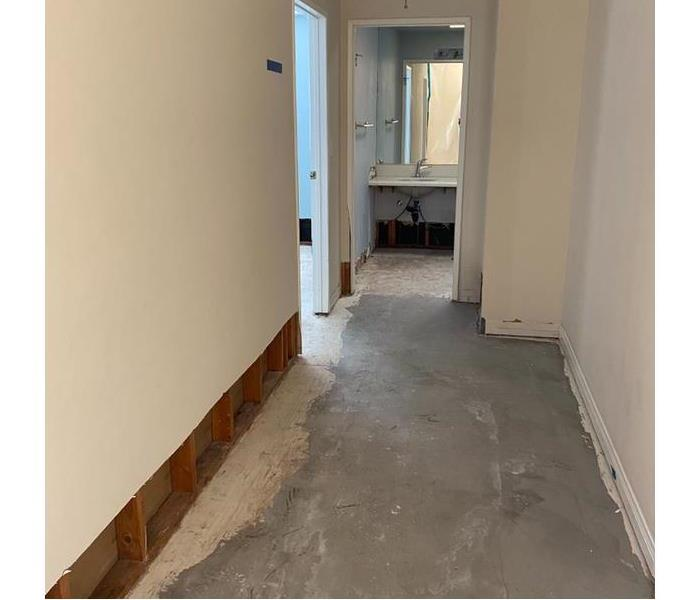 Photo of hallway without any equipment and evenly cut out drywall.