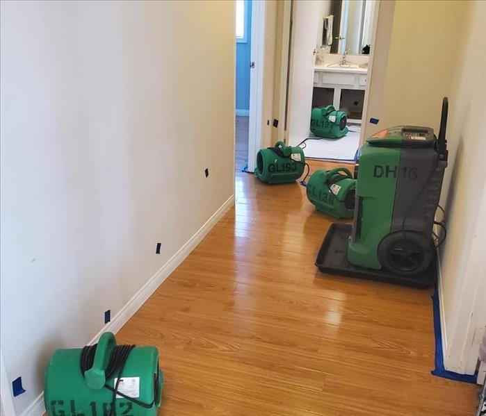 Photo of hallway with professional SERVPRO drying equipment