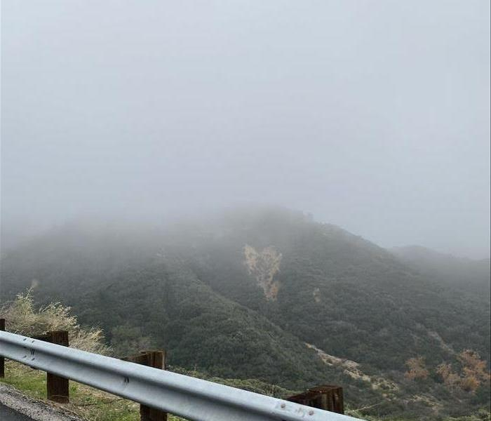 Foggy, overcast mountain from high way.